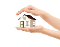 Picture of woman's hands holding a house Royalty Free Stock Photos