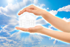 Picture of woman's hands holding a house Stock Images