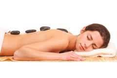 Picture of woman in spa salon with hot stones Royalty Free Stock Photo