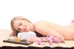 Picture of woman in spa salon lying on the massage desk Royalty Free Stock Photography
