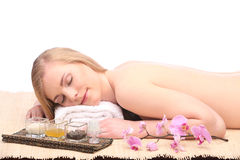 Picture of woman in spa salon lying on the massage desk Stock Images