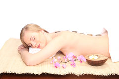 Picture of woman in spa salon lying on the massage desk Stock Photo