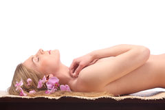 Picture of woman in spa salon lying on the massage desk Royalty Free Stock Images