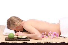 Picture of woman in spa salon lying on the massage desk Royalty Free Stock Photos