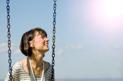 Picture of a woman on the swing Royalty Free Stock Photos