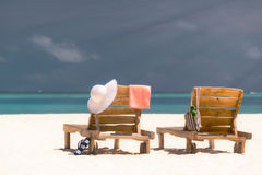 Picture of wooden beach chairs on the tropical beach, vacation. Stock Photo