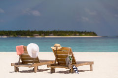 Picture of wooden beach chairs on the tropical beach, vacation. Stock Image