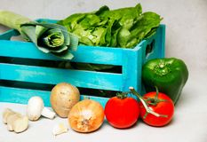 A picture of a wooden box of cooking ingredients. A colorful picture of cooking ingredients healthy and mouth watering Stock Images