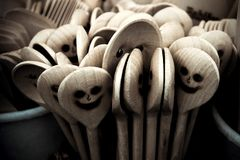 Picture of the wooden cooking spoons with faces. A detail picture of the wooden cooking spoons with carved faces. They are smiling, but also look a bit scary Stock Image