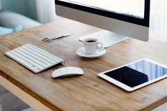 Picture of office desk with tablet computer and other accessories Royalty Free Stock Images