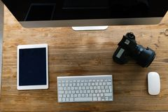 Picture of office desk with tablet computer and other accessories Royalty Free Stock Photography