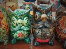 Bird-shaped wooden statues royalty free stock photography