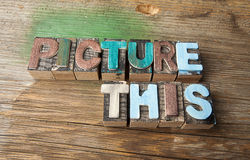 Picture This - Wooden typeset word concept. Picture This in multicolor wooden letterpress letter printing blocks Royalty Free Stock Photo