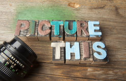 Picture This - Wooden typeset word concept. Picture This in multicolor wooden letterpress letter printing blocks with retro camera lens Royalty Free Stock Photos