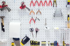 Picture of working tools hanging on board Royalty Free Stock Photography