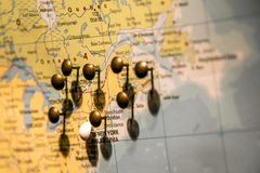 Picture of World Map Travel concept with many pushpins pins East USA and Canada. Picture of World Map Travel concept with many pushpins pins in East USA and stock image