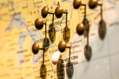 Picture of World Map Travel concept with many pushpins pins East USA and Canada. Picture of World Map Travel concept with many pushpins pins in East USA and Stock Images