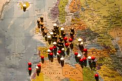 Picture of World Map Travel concept with many pushpins pins Europe and surrounding countrys. Picture of World Map Travel concept with many pushpins pins in Stock Photos