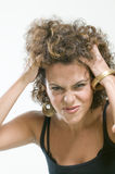 Picture of worried woman holding her hair. Close up picture of worried looking woman holding her hair Royalty Free Stock Photography