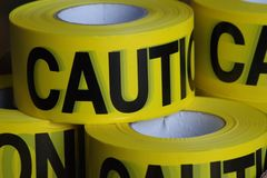 Yellow caution tape ready for use. royalty free stock photography