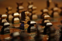 Knight versus pawn in a chess game stock image