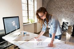 Picture of young architect working in office stock photo