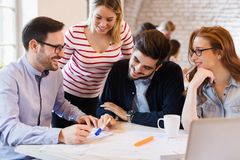 Picture of young architects discussing in office Royalty Free Stock Photography
