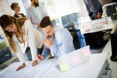 Picture of young architects discussing in office. Picture of young architects discussing in modern office royalty free stock photo