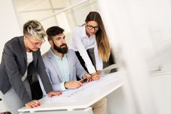 Picture of young architects discussing in office. Picture of young architects discussing in modern office stock photography
