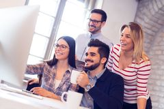 Picture of young architects discussing in office. Picture of young attractive architects discussing in office royalty free stock photo