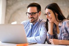 Picture of young architects discussing in office stock images