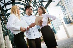 Picture of young attractive business partners standing Stock Images