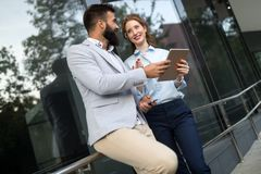 Picture of young attractive business partners standing. Outdoor stock images