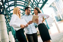 Picture of young attractive business partners standing stock image
