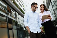 Picture of young attractive business partners standing royalty free stock photography