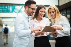 Picture of young attractive business partners standing royalty free stock photos