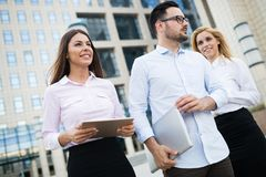 Picture of young attractive business partners standing Royalty Free Stock Images