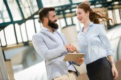Picture of young attractive business partners standing Stock Photography
