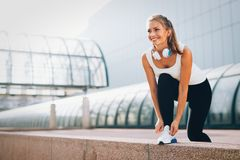 Picture of young attractive happy fitness woman. On break Royalty Free Stock Photography