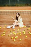 Picture of young beautiful brunette woman playing tennis on cour Stock Photos