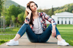 Picture of young beautiful woman with headphones listening music Stock Photos