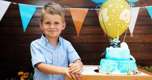 Picture of young boy at birthday party. Picture of young pretty boy at birthday party Royalty Free Stock Photo