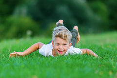 Young boy playing in the grass Royalty Free Stock Images