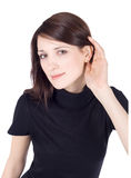 Picture of young brunette listening gossip Stock Images