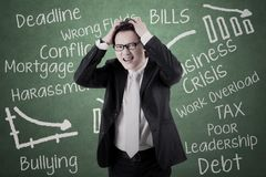 Businessman looks stressed with his problems Royalty Free Stock Photography