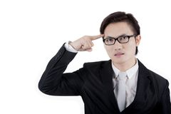 Young businessman thinking an idea on studio Royalty Free Stock Images