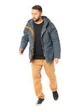 Picture of a young casual macho in a cold season jacket Stock Image