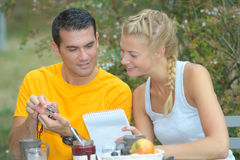 Picture young couple having breakfast outside Stock Photo