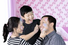 Father and children playing with face painting Royalty Free Stock Photos