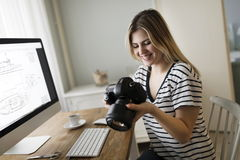 Picture of young female designer holding camera stock photos